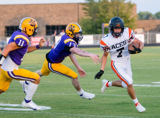Amanda- Clearcreek's Grant Guiler avoids a tackle by Unioto's Tayvion Galloway during a game at Unioto High School on August 27, 2021. Amanda Clearcreek defeated Unioto 30-3.