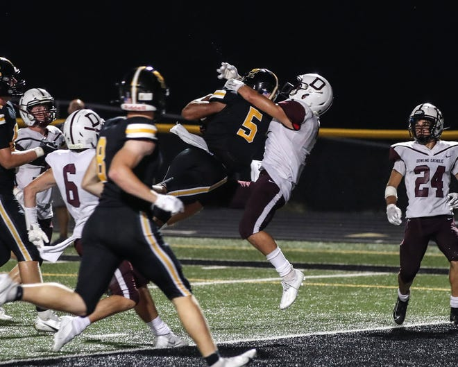 Southeast Polk's Xavier Nwankpa (5), a Notre Dame recruiting target, catches the game-winning touchdown on the final play of the game against Dowling Catholic at Southeast Polk (Iowa) High School on Friday, Aug. 27, 2021. The Rams beat the Maroons 13-7.