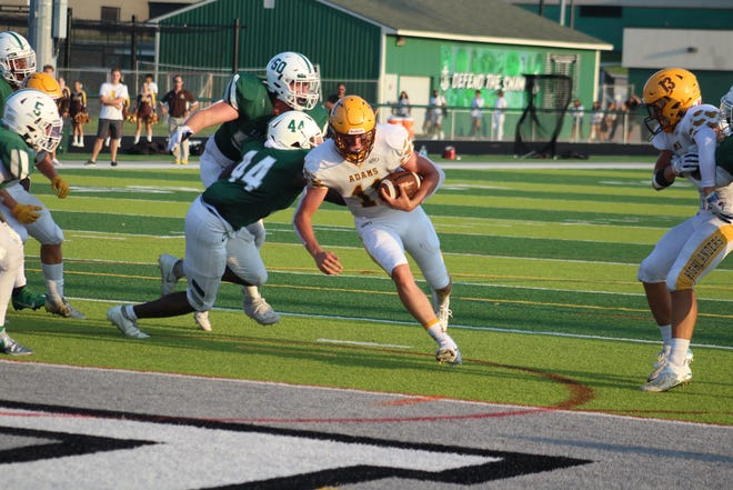 Rochester Adams junior quarterback Parker Picot crosses the goal line with the first of his three rushing touchdowns Friday night. He totaled 210 yards on the ground in leading the Highlanders to a 35-17 win over defending state champion West Bloomfield.