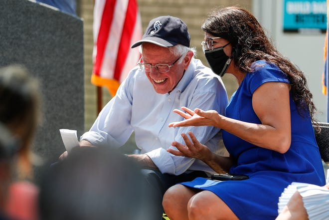 Sen. Bernie Sanders talks to Rep. Rashida Tlaib during a town hall at Eastside Community Network in Detroit, Saturday, August 28, 2021.