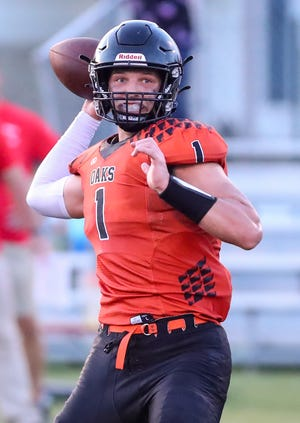 Oakfield's Grant Bass throws a pass against Sturgeon Bay during their game earlier this season in Oakfield.