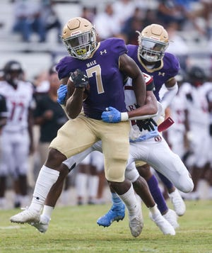 Male's Daniel Swinney had 207 yards and two touchdowns on 16 carries in the first half against Ballard during Friday night's game. August 27, 2021