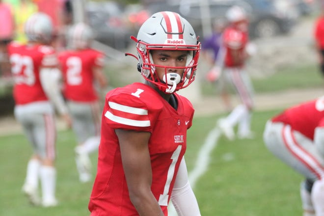 Shelby's Andre Hill caught eight passes for 201 yards and two touchdowns and picked off two passes on defense in a 45-28 win over Lexington.