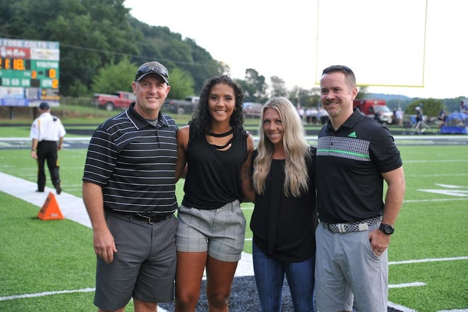 Four new members of the Clear Fork Valley Athletic Hall of Fame wereintroduced before Friday's football game against Granville. Pictures from left to right are inductees Jeff Gottfried, Deijah Swihart, Taylor Kline and Scott Sellers.