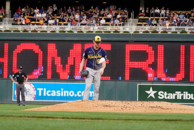 Brewers pitcher Eric Lauer tosses his rosin bag after giving up a two-run home run to the Twins' Josh Donaldson in the first inning Friday