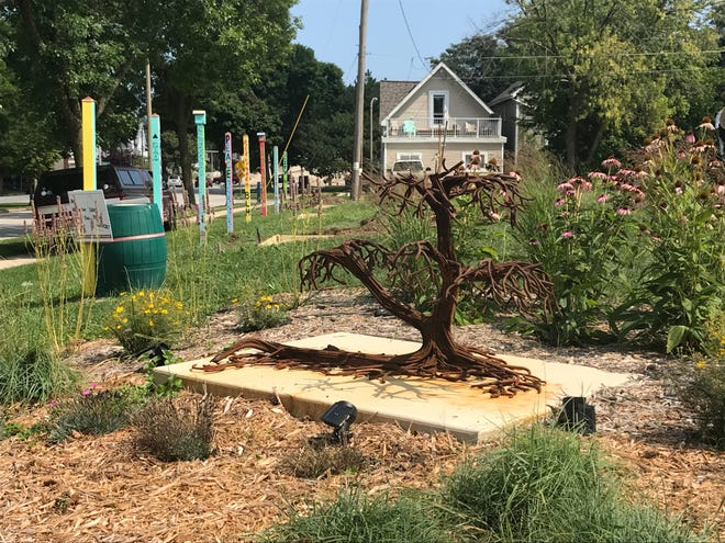 One of the sculptures by Cory Malchow is installed at an empty lot at North Richards and East Locust streets, which is being turned into a sculpture garden as part of Healing Spaces, a city-led initiative to repurpose vacant city lots and reduce blight.