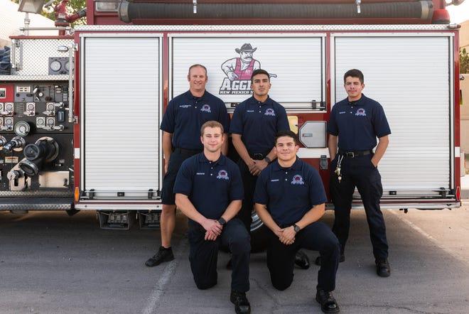 Back row: Capt. Kellen Tarkington of New Mexico State University Fire Department, left, Damian Davila and Juan Aristizabal, who are both NMSU student firefighters. Front row: Tyler Laramore, left, and Matthew Holguin, who also are NMSU student firefighters.