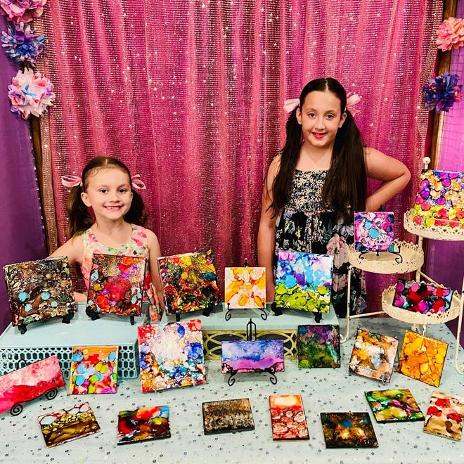 Sisters Elin, 7, and Ayla, 11, Whiteley make tile art using alcohol ink. The siblings sell the pieces through their business, Tile Style.