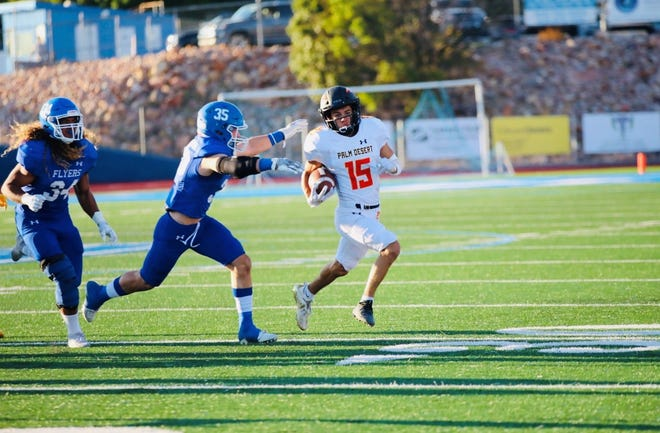Senior receiver Robert Bianco runs with the ball versus Dixie High in St. George, Utah on Friday, Aug. 27, 2021.