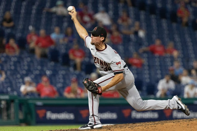 Tyler Clippard went on the COVID-19 injured list due to virus-related symptoms, manager Torey Lovullo said before Tuesday's game against the Texas Rangers.