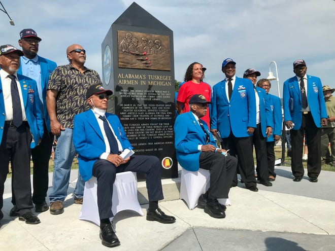 Tuskegee Airmen Lt. Col. Harry Stewart, Lt. Col. Alexander Jefferson and others pose for photos near the Port Huron monument honoring the Tuskegee Airmen on Aug. 28, 2021.