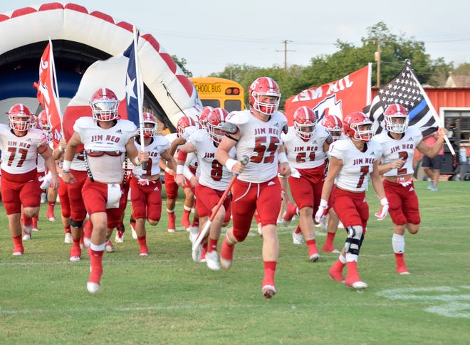 The Jim Ned Indians run onto the field at Bearcat Stadium in Ballinger before their season-opening game Friday, Aug. 27, 2021.