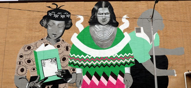 A mural of Zora Neale Hurston, Betty Mae Jumper and Marjorie Harris Carr was unveiled Friday, Aug.27, 2021 in Downtown Tallahassee.