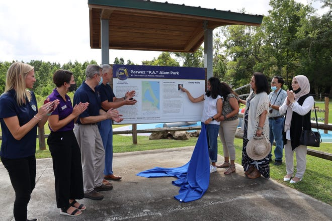 """Parwez """"P.A."""" Alam park dedication at Okeeheepkee Prairie Preserve. Pictured (left to right): Amanda Heidecker, Leon County Parks and Recreation Director; Amanda Lewis, Owner of Future Pathways; Rick Minor, Leon County Commission Chairman and District 3 Commissioner; Vince Long, Leon County Administrator; Zahra Alam, P.A.'s daughter; Adeena Alam, P.A.'s daughter; Ghazala Alam, P.A.'s sister"""