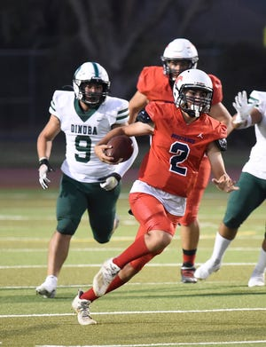 Tulare Western's Carmine Ficher runs the ball during a non-league high school football game between Dinuba and Tulare Western on August 27, 2021.