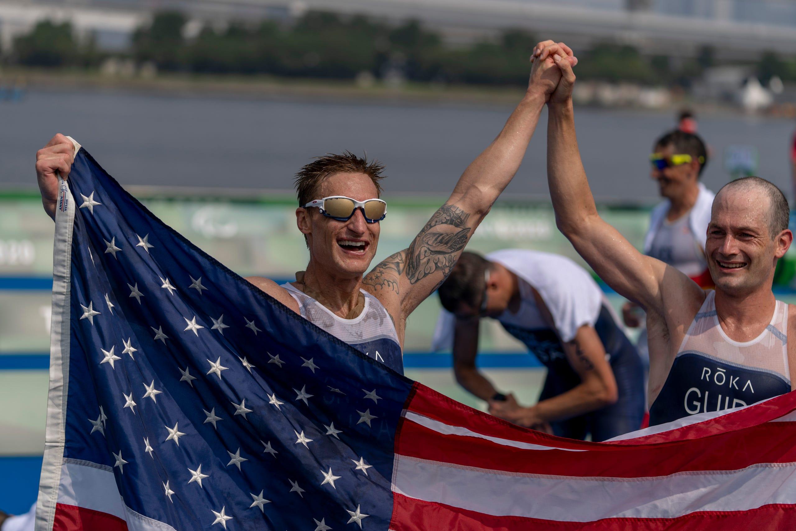 Aug. 27: Team USA's Brad Snyder and guide Greg Billington, celebrate after wining the Men's Triathlon PTV1 at the Odaiba Marine Park.