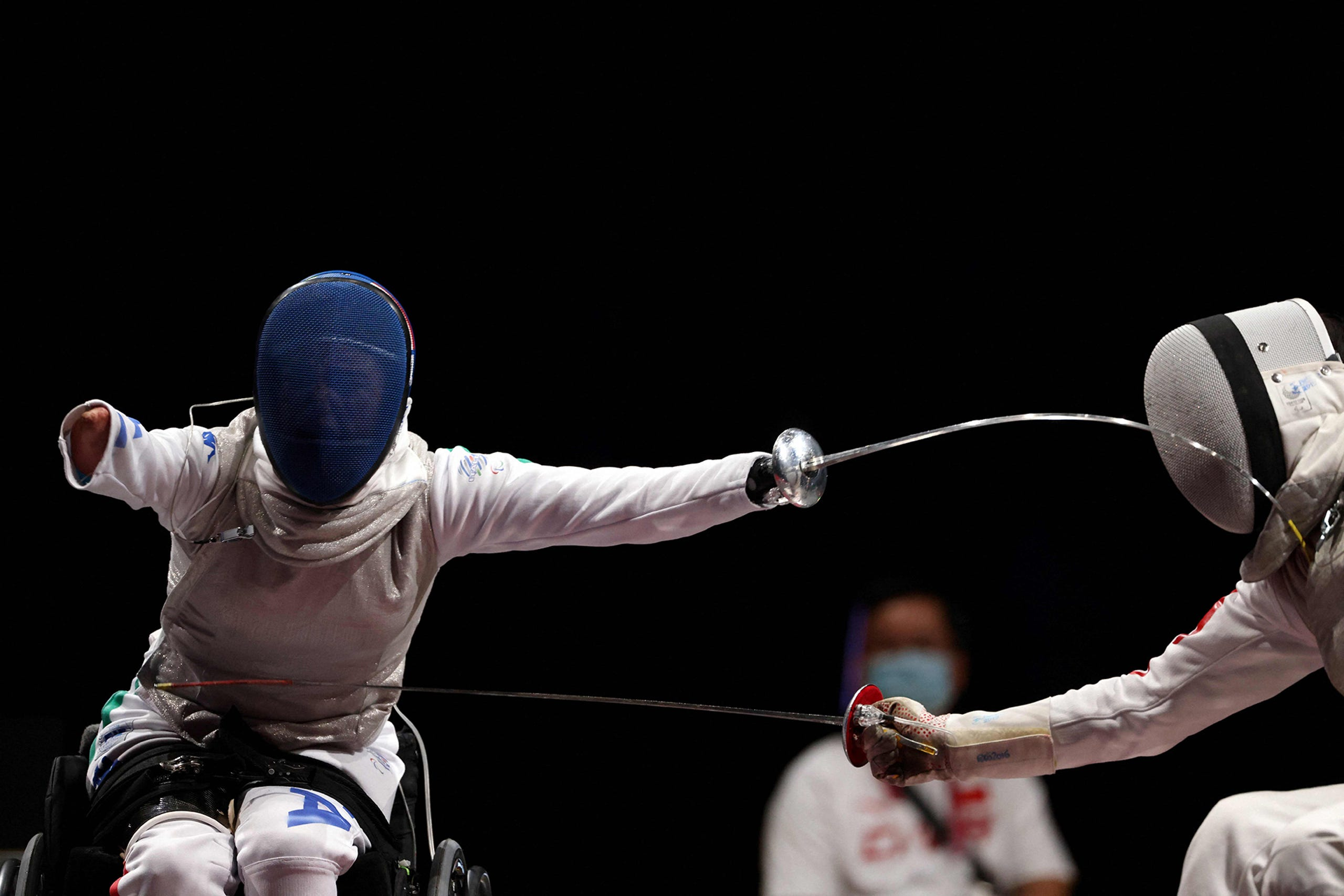 Aug. 28, 2021: Italy's Beatrice Vio (L) reacts for a point as she competes with China's Jingjing Zhou in the wheelchair fencing women's foil individual category B final bout during the Tokyo 2020 Paralympic Games at Makuhari Messe Hall in Chiba .