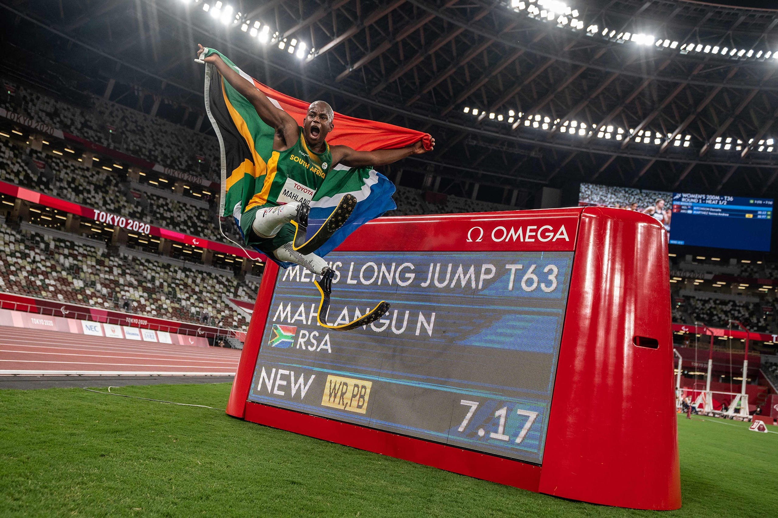 August 28, 2021: South Africa's Ntando Mahlangu celebrates after winning the men's long jump - T63 final of the Tokyo 2020 Paralympic Games at the Olympic Stadium in Tokyo.