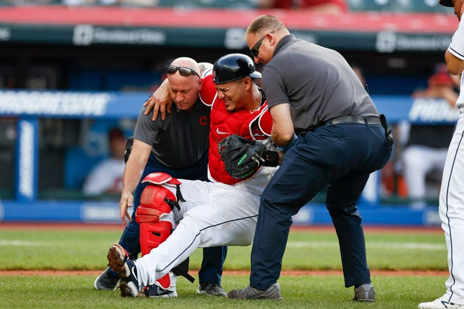 Cleveland catcher Wilson Ramos will have surgery on his knee and miss the rest of the season after being injured Sunday against the Boston Red Sox. [Ron Schwane/Associated Press]