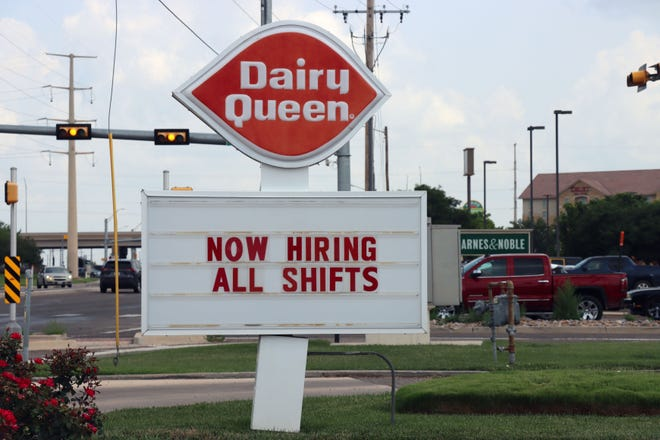 """The marquee at Dairy Queen at 2601 S Soncy Road says """"now hiring - all shifts""""."""