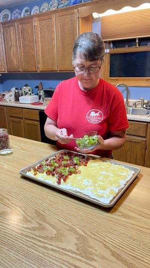 Esther Keim making the fruit pizza.