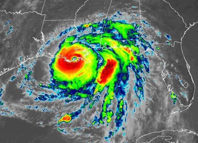 A color-enhanced satellite image shows Ida early Sunday afternoon just after making landfall near Port Fourchon as a Category 4 hurricane.