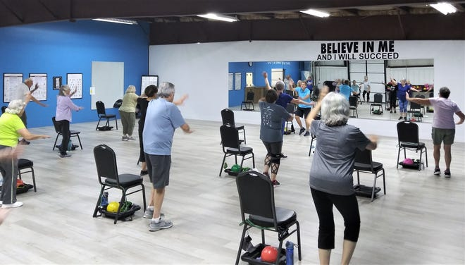 Cheryl Seabright puts her Friday morning SilverSneakers class through their workout. Seabright was nominated as SilverSneakers Instructor of the Year. She finished in the top 10 in the nation.