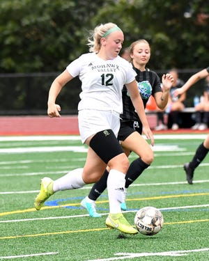Jazmyn Gillette (12) advances the ball for Mohawk Valley Community College against Finger Lakes Community College Saturday. Gillette, a Central Valley Academy graduate, was playing her first match after transferring from Herkimer College.