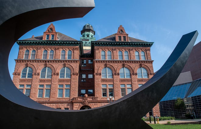 """The seat of city government, Peoria City Hall, 419 Fulton St. in Downtown Peoria, is framed in the recently restored """"Sonar Tide"""" sculpture. City Hall was built in 1899."""
