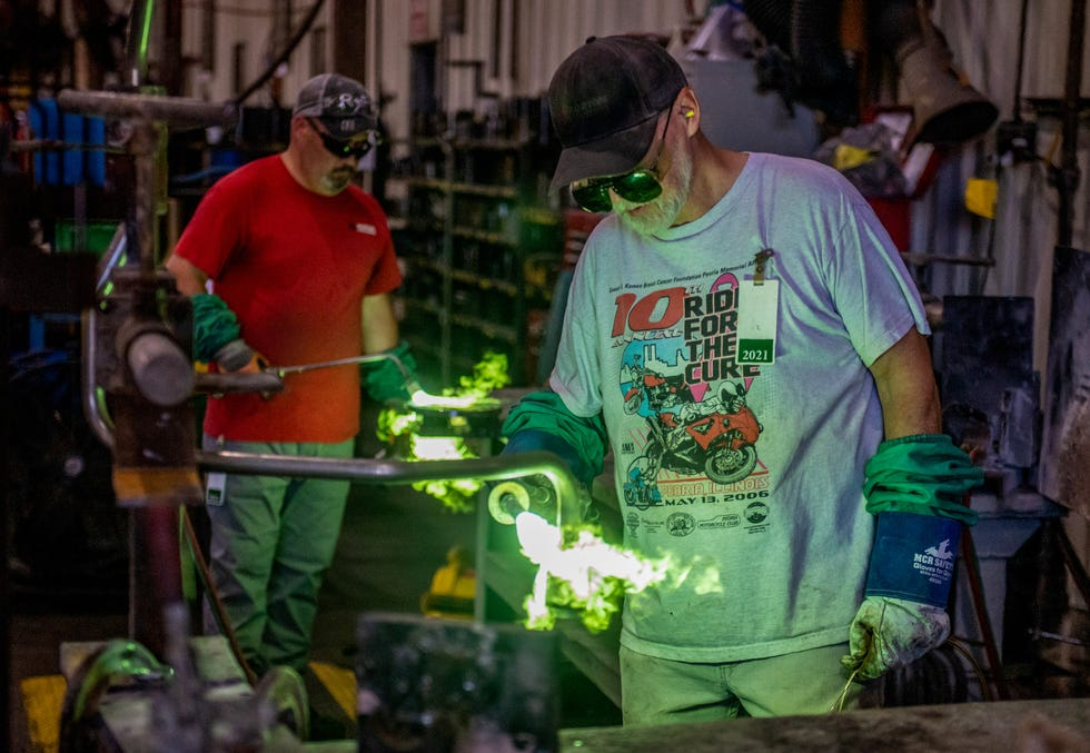 Braze operators David Smith, foreground, and Billy Atwater braze components together at Morton Industries on Commerce Drive in Morton.