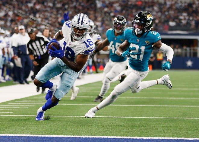 Dallas Cowboys wide receiver Aaron Parker (18) scores a touchdown against Jacksonville Jaguars cornerback Sidney Jones in the second quarter on Sunday at AT&T Stadium.