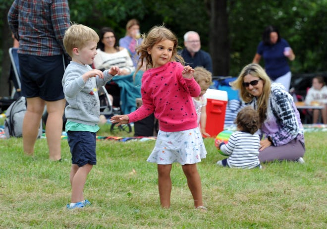 Nicholas Smith, 4, left, and Evelyn Turner, 4, both of Hingham, dance to the music during the Summer Send-Off at World's End in Hingham, Saturday, Aug. 28, 2021.