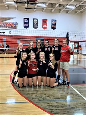 Johannesburg-Lewiston volleyball poses with their first-place prize. The Cardinals are now 11-0 to start the season.