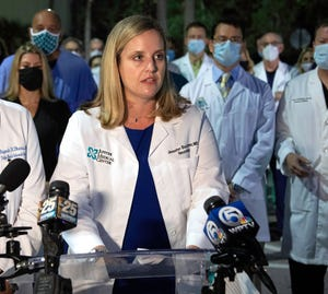 Dr. Jennifer Buczyner of Jupiter Medical Center speaks as a group of physicians and administrators from around Palm Beach County gathered in Palm Beach Gardens last month to support vaccinations ... in their fight against COVID-19.
