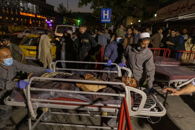 Victims of a suicide attack at Kabul's airport arriving at a hospital in Kabul, Afghanistan on Thursday, Aug. 26, 2021. The group, known as Islamic State Khorasan Province, ISIS-K or ISIS-KP, is an Afghan affiliate of ISIS, and claimed credit for the attack.