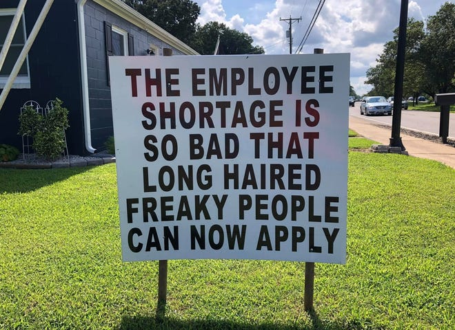 A sign located on the 4700 block of West Hundred Road in Chester, Va., references a line from the early '70s rock song 'Signs.'