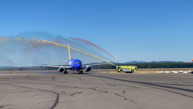 A firetruck shoots ceremonial red, blue and yellow water over the first Southwest Airlines flight from Las Vegas that landed in Eugene Sunday.