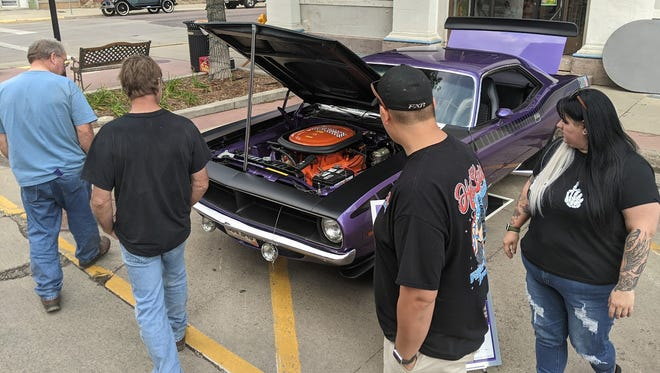 One of the popular attractions at Sizzlin' Summer Nights downtown Saturday was this 1960 Plymouth Barracuda owned by Craig Golz.