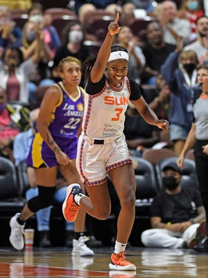 Connecticut Sun forward Kaila Charles celebrates a basket against the Los Angeles Sparks on Saturday in Uncasville.