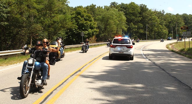 Motorcyclists ride west on Fifth Street after leaving American Legion Gillen Post 33 in Bedford Saturday. The riders were participating in the Charity Parker Poker Run, a benefit for Parker, who was seriously injured in a motorcycle accident May 22. Her husband Michael was killed in the crash.