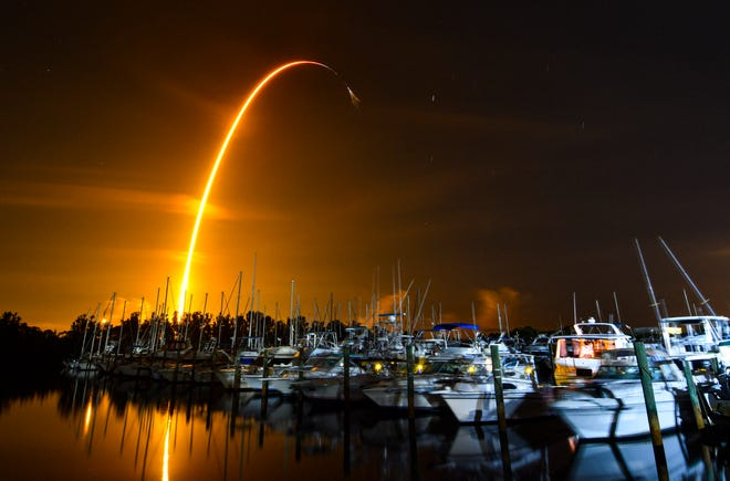 A SpaceX Falcon 9 rocket launches from Kennedy Space Center with a Cargo Dragon capsule on Sunday, Aug. 29, 2021, in this long-exposure photo captured on Merritt Island.