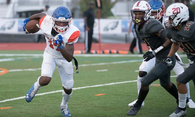 Millville's Lotzeir Brooks runs the ball during the Battle at the Beach football game between Millville and Union played in Ocean City on Saturday, August 28, 2021.  Millville defeated Union, 31-28.