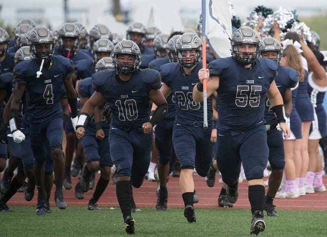 The Timber Creek High School football team enters the field prior to the Battle at the Beach football game between Red Bank Catholic and Timber Creek played in Ocean City on Saturday, August 28, 2021.