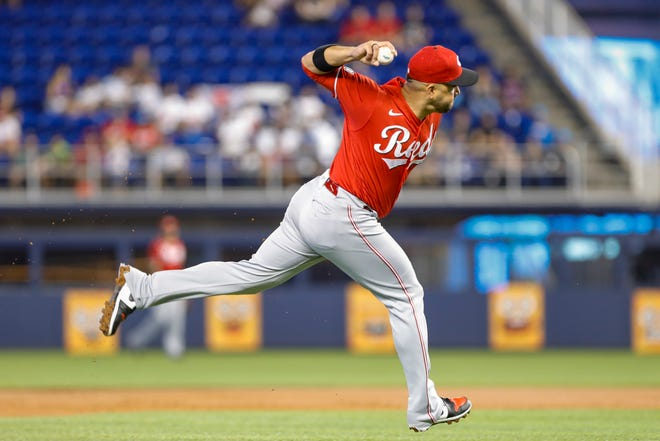 Aug 29, 2021; Miami, Florida, USA; Cincinnati Reds third baseman Eugenio Suarez (7) throws to first base and takes out Miami Marlins third baseman Brian Anderson (not pictured) during the first inning at loanDepot Park. Mandatory Credit: Sam Navarro-USA TODAY Sports