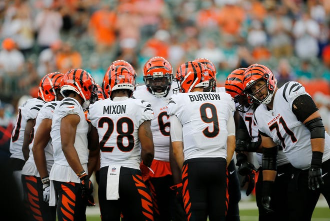 Cincinnati Bengals quarterback Joe Burrow (9) leads a huddle before the first drive in the first quarter of the NFL Preseason Week 3 game between the Cincinnati Bengals and the Miami Dolphins at Paul Brown Stadium in downtown Cincinnati on Sunday, Aug. 29, 2021.
