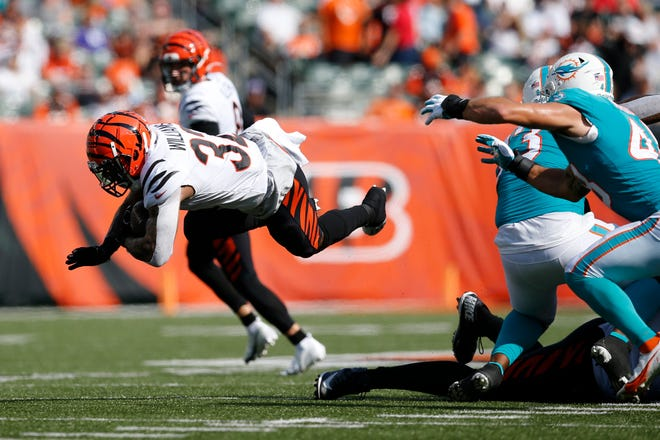 Cincinnati Bengals running back Trayveon Williams (32) is tripped on a carry in the second quarter of the NFL Preseason Week 3 game between the Cincinnati Bengals and the Miami Dolphins at Paul Brown Stadium in downtown Cincinnati on Sunday, Aug. 29, 2021.