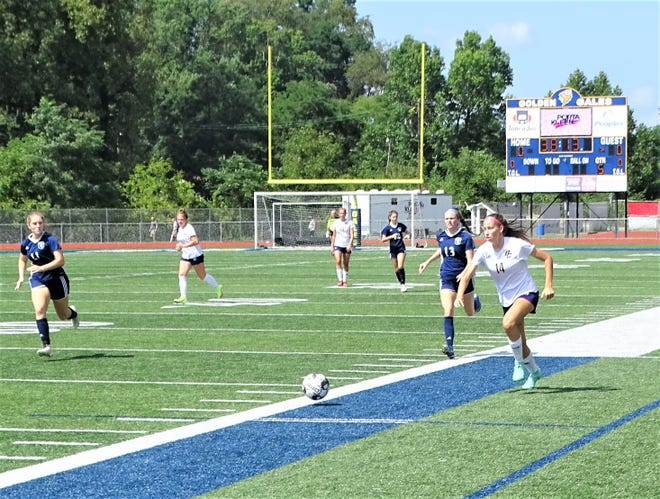 Bloom-Carroll junior Jordyn Adams moves the ball up the field ahead of Lancaster's Eve Harrison during their non-conference game Saturday at Fulton field. The Bulldogs pulled out a hard-fought 5-4 win.
