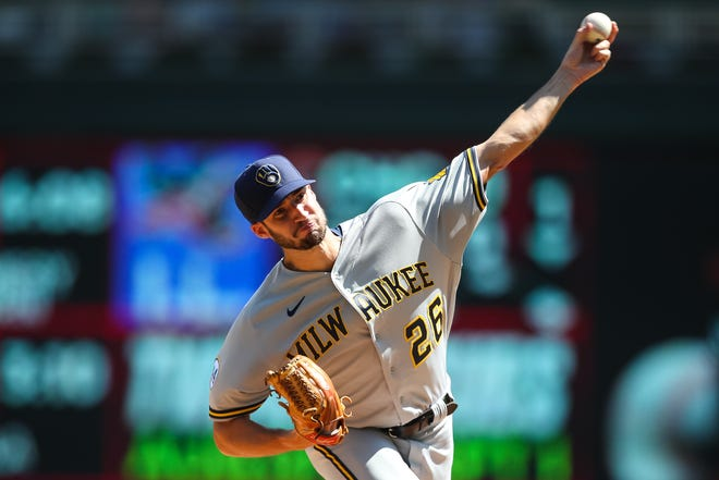 Brewers starting pitcher Aaron Ashby works against the Minnesota Twins in the first inning Sunday at Target Field. He recorded his first major-league victory of his career.