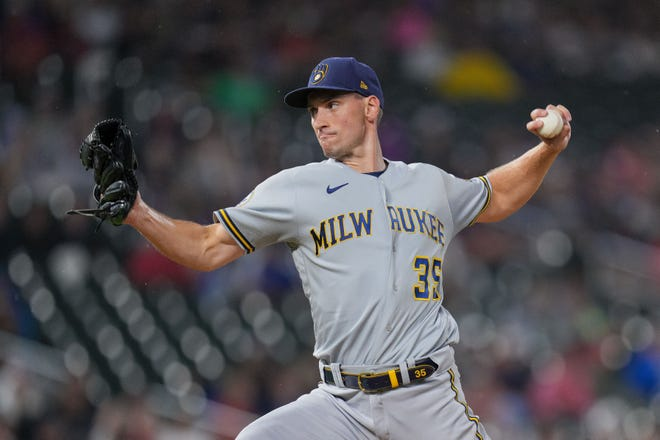 Aug 28, 2021; Minneapolis, Minnesota, USA; Milwaukee Brewers relief pitcher Brent Suter (35) pitches against the Minnesota Twins in the seventh inning at Target Field. Mandatory Credit: Brad Rempel-USA TODAY Sports