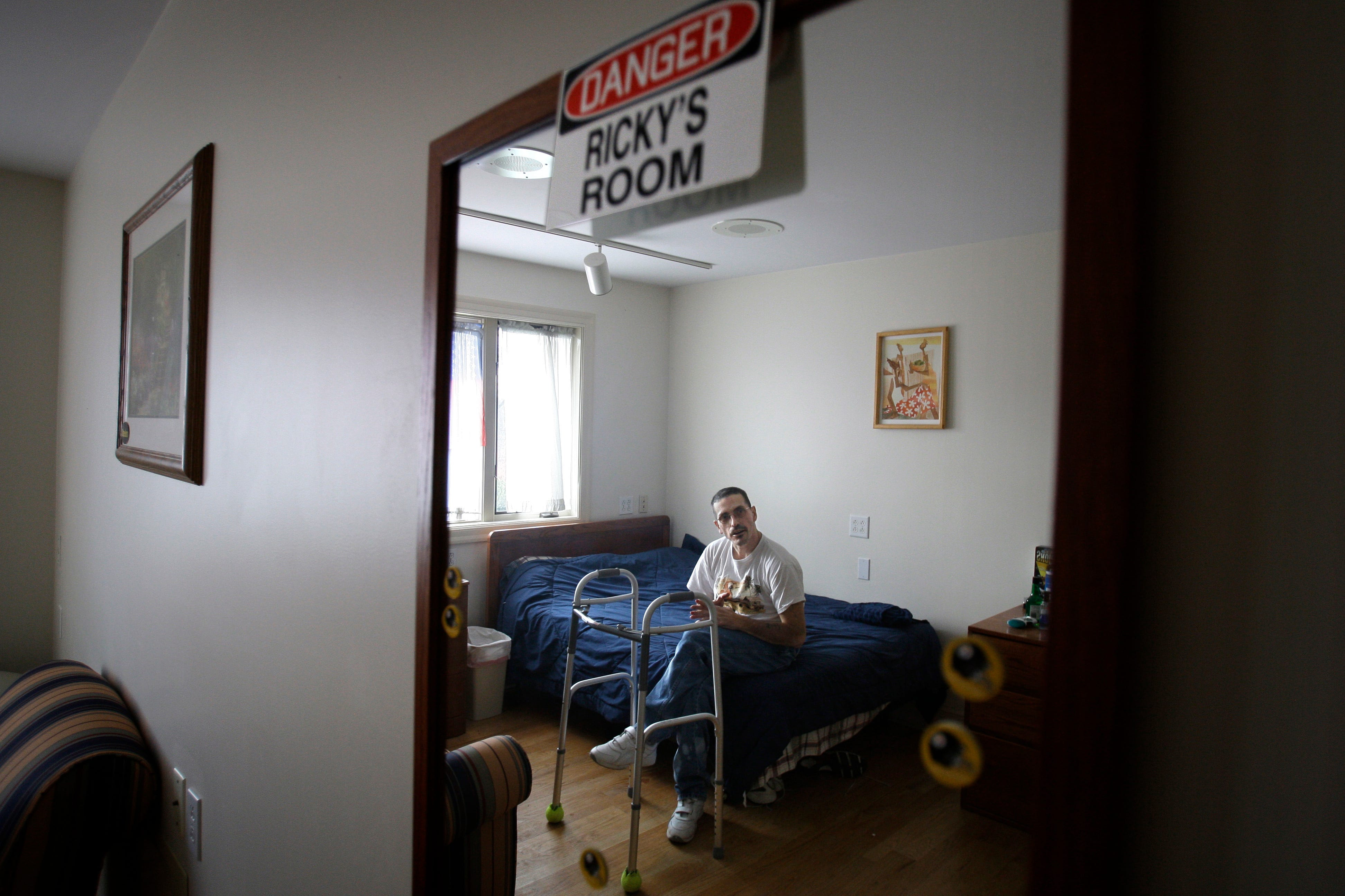 Rickie Ullmon was a longtime resident of Mayview State Hospital in Pennsylvania, with little hope of ever being released. But after the hospital closed in 2008, nearly all residents were placed in housing in the community. In this photo from 2010, Ullmon shows off his room in a group home.